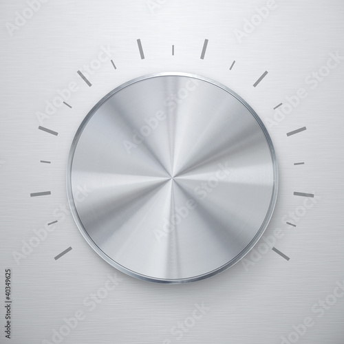 Shiny silver volume knob over brushed metal background