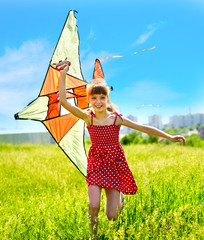Child flying kite outdoor.