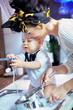 Beautiful baby help with washing