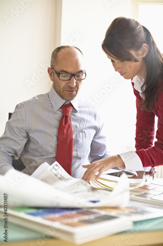 Business woman and business man working in office