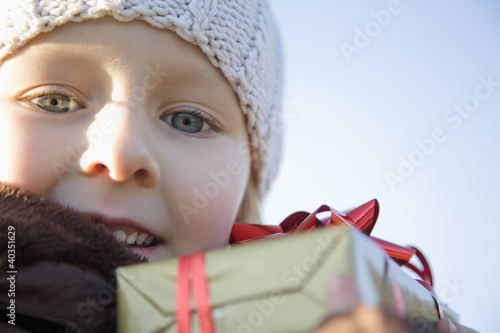 Girl holding gift box, portrait