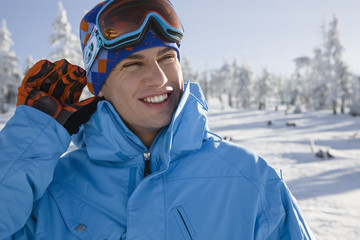 Young man wearing ski goggles