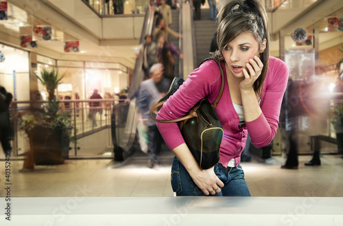 Young woman in shopping center