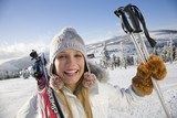 Young woman holding ski pole, portrait