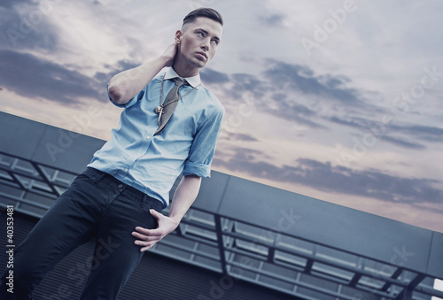 Handsome guy on a roof of a building