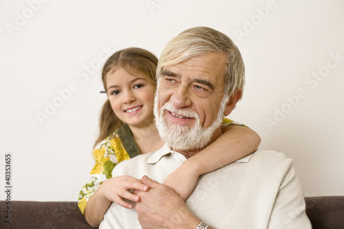 Grandfather with granddaughter, smiling