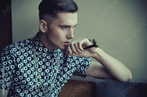Vogue style portrait of a young guy
