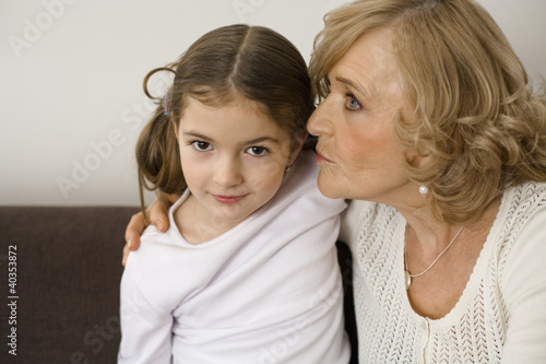 Senior woman kissing daughter, close-up