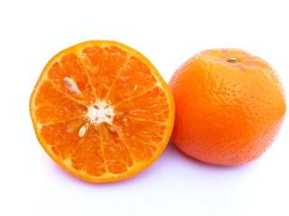 half sliced and one whole orange