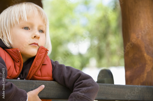 Girl leaning on rail, close up