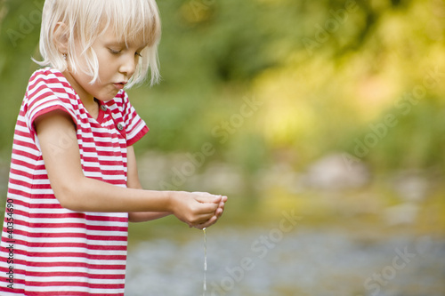 Girl playing in stream
