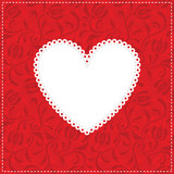 White lacy heart on red ornamental background.