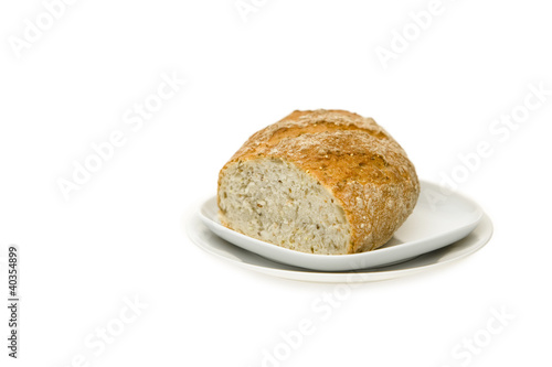 Loaf of bread on plate, close-up