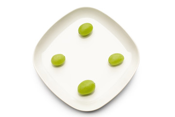 Green grapes on plate, directly above