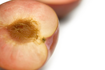 Close up of peach cut in half