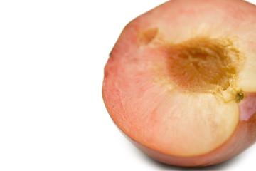 Close up of peach cut in half