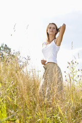 Mid adult woman standing in field