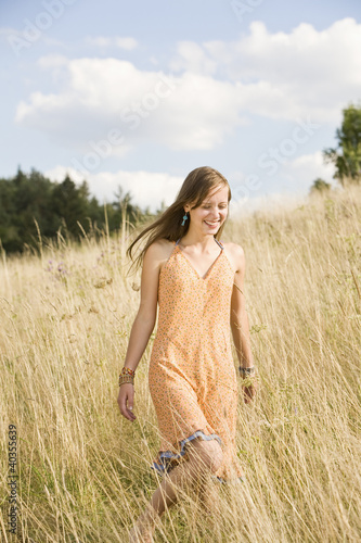 Mid adult woman enjoying in field