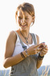 Mid adult woman holding mobile phone