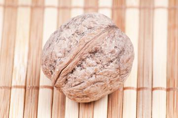 Close up Walnut on bamboo background