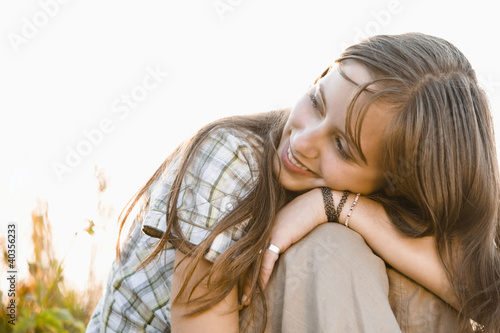 Mid adult couple embracing in field, portrait