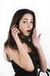 Upset teenage girl talking on the phone