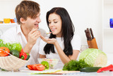 Fototapety young couple in kitchen