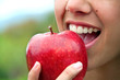 Leinwandbild Motiv Biting an apple