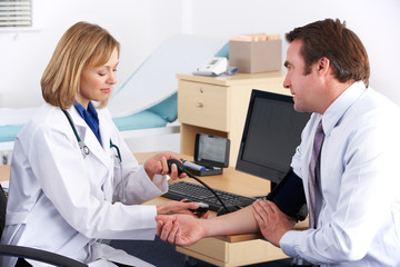 American doctor taking patient's blood pressure