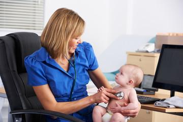 UK doctor examining baby