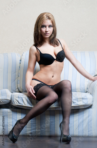 Shot of a sexy woman on the sofa