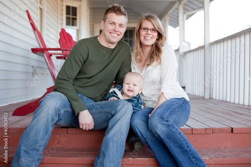 Happy Young Family on Porch
