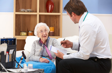 UK GP visiting senior woman at home