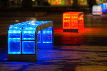 Illuminated multicolored benches at night in Hannover, Germany