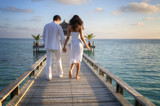 Sensual happy lovers in white clothes on the beach (Maldives)