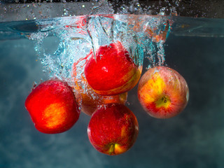 Delicious Apples Submerged Underwater