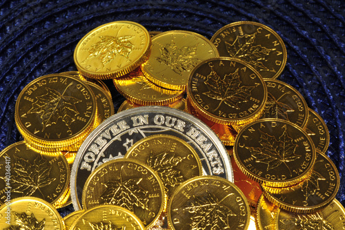 Gold and silver coins on a blue background