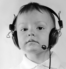 little boy wearing telephone headset