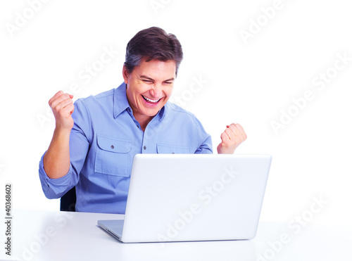 Happy man with laptop computer.