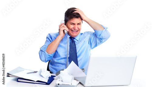 Busy businessman with laptop computer.