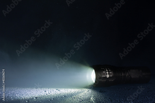 Tactical waterproof flashlight with waterdrops and smoke