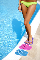 Female legs with colorful slippers