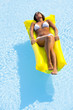 Beautiful woman relaxing on pool