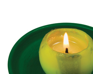 Green lit candle macro closeup, isolated