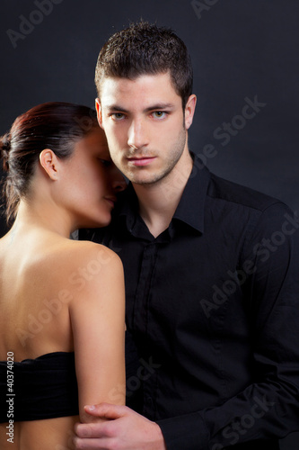 Couple in love with handsome man and rear woman