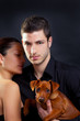 Couple in love with brown little pet puppy dog