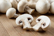 Fresh sliced mushrooms at wooden cutting board