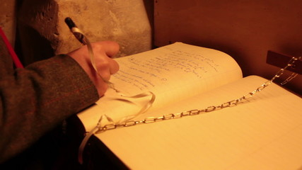 Woman write on a guestbook in church