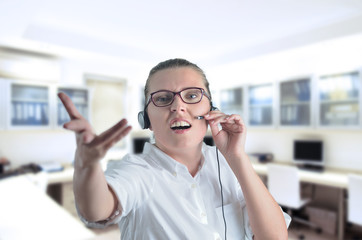 blondy beautiful angry girl with headphone in call center