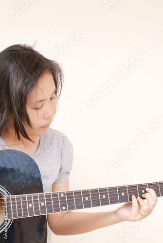 Woman playing classic acoustic guitar.